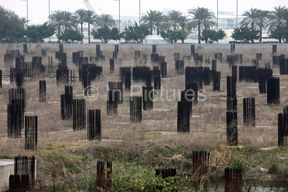 A field of steel rebars meant to be made into structural posts of a now abandoned development sits in Macau, China on 28 January 2011. Macau experienced a building boom in the past few years as the gambling industry reaped profits from the influx of Chinese mainland gamblers, possibly creating a property bubble in the process.