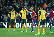Crystal Palace's Andros Townsend celebrates scoring his sides opening goal as Arsenal's Mesut Ozil looks on dejected during the Premier League match at Selhurst Park Stadium, London. Picture date: April 10th, 2017. Pic credit should read: David Klein/Sportimage