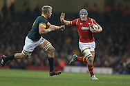 Jonathan Davies of Wales goes past Pieter-Steph du Toit of South Africa. Under Armour 2016 series international rugby, Wales v South Africa at the Principality Stadium in Cardiff , South Wales on Saturday 26th November 2016. pic by Andrew Orchard, Andrew Orchard sports photography