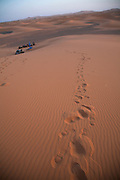 Footprints in sand Camel trekking through the sand dunes of Merzouga, Morocco