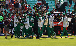 June 18, 2017 - London, United Kingdom - Pakistan players with Trophy.during the ICC Champions Trophy Final match between India and Pakistan at The Oval in London on June 18, 2017  (Credit Image: © Kieran Galvin/NurPhoto via ZUMA Press)