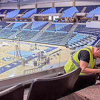 010714       Cable Hoover<br /> <br /> Clay Dennison bolts the seats into the VIP lounge of the Fighting Scouts Events Center in Ft. Defiance Tuesday. The $37 million, 6,500-seat arena is set to open January 22. The Scouts will face the Paige Sundevils in the venue's first match January 25.