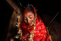 Sumeena Shreshta Balami, 15, leaves her home to meet her groom, Prakash Balami, 16, in Kagati Village, Kathmandu Valley, Nepal on Jan. 24, 2007. The harmful traditional practice of early marriage is common in Nepal. The Kagati village, a Newar community, is most well known for its propensity towards this practice. Many Hindu families believe blessings will come upon them if marry off their girls before their first menstruation.