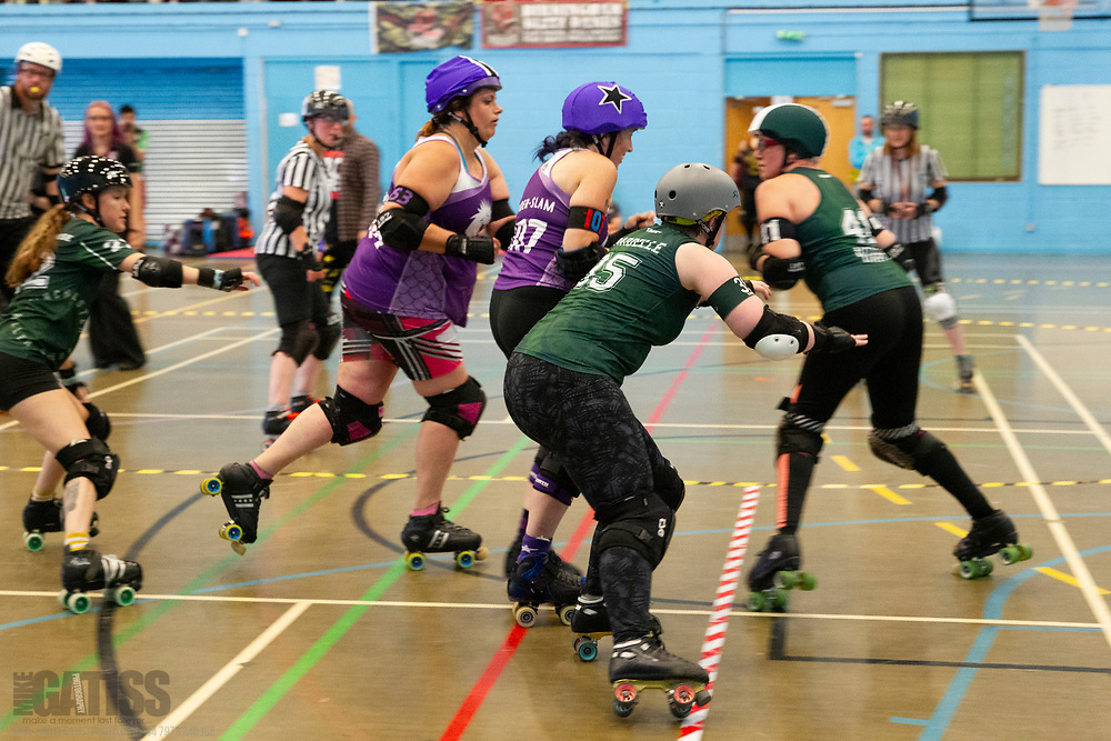 Manchester Roller Derby's Furies take on North Wales Roller Derby B for 4th place overall in the Bouddica Cup 2019 at the University of Salford Sports Centre, Salford, UK 2019-08-03
