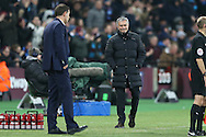 Jose Mourinho, the Manchester United manager smiling at Slaven Bilic, the West Ham United manager from the touchline. Premier league match, West Ham Utd v Manchester Utd at the London Stadium, Queen Elizabeth Olympic Park in London on Monday 2nd January 2017.<br /> pic by John Patrick Fletcher, Andrew Orchard sports photography.