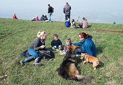 © Licensed to London News Pictures. 29/03/2014<br /> <br /> Eston Hills, Teesside, United Kingdom<br /> <br /> A family who are part of a community group called the Friends of Eston Hills gather for a picnic on the top of Eston Nab in Teesside. The group who have recently raised £15000 in just seven weeks to buy the land and return it to public ownership gathered to celebrate on top of the Nab.<br /> <br /> The area will now be returned to public ownership for the first time in hundreds of years and there are plans to raise more funds to create a heritage trail, clean the site up and create a memorial to 375 miners who died when there was an iron mine on the site.<br /> <br /> <br /> Photo credit : Ian Forsyth/LNP