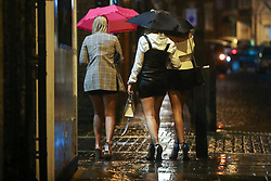 © Licensed to London News Pictures. 03/10/2020. Liverpool, UK. Drinkers not deterred by bad weather of Storm Alex in Liverpool as well as newly imposed lockdown restrictions which prevent socialising indoors with other households.. Photo credit: Kerry Elsworth/LNP