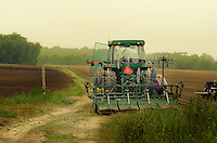 Maintenance work being done on a tractor attachment needed in the preparation of the fields for the spring plantings.