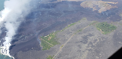 July 5, 2018 - Hawaii, U.S. - Aerial view of the lava channel and active margins between Kapoho Crater (upper right) and the coast (lower left). The northern margin of the flow field is advancing at several points in the area of Kapoho Ag and Beach Lots (vegetated areas in center of image). Image courtesy of Hawaii County Fire Department. (Credit Image: © USGS/ZUMA Wire/ZUMAPRESS.com)