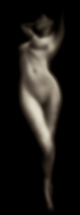 It is interesting indeed that a piece called Purity No 3 would feature a nude form in a blurred form. We can certainly guess that the body is female, but it is ultimately difficult to say for absolute certain. This is a piece in which the subject seems to sinking into something, or slipping into some other world entirely. There is something deep and rich to the mystery suggested by this piece, which is based upon the first black/white photographs to create light atmosphere via long exposure times. This thrilling, singular piece is available as wall-art, t-shirts, or through interior products. .<br /> <br /> BUY THIS PRINT AT<br /> <br /> FINE ART AMERICA<br /> ENGLISH<br /> https://janke.pixels.com/featured/purity-no-3-jan-keteleer.html<br /> <br /> WADM / OH MY PRINTS<br /> DUTCH / FRENCH / GERMAN<br /> https://www.werkaandemuur.nl/nl/shopwerk/Naakte-vrouw---Purity-No-3/436235/134