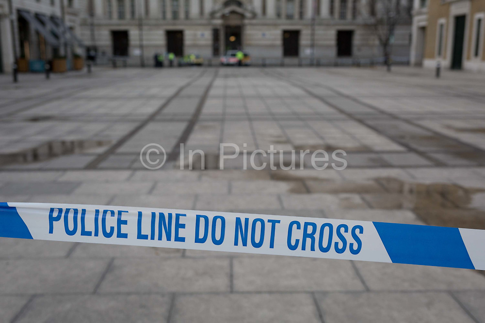 Police tape closes a square on the Southbank, four people were killed including the attacker and 20 injured during a terrorist attack on Westminster Bridge and outside the Houses of Parliament, on 22nd March 2017, in central London, England. Parliament was in session and all MPs and staff and visitors were in lock-down while outside, the public and traffic were kept away from the area of Westminster Bridge and parliament Square, the scenes of the attack. It is believed a lone man crashed his car into pedestrians then, armed with a knife tried to enter Parliament, stabbing and killing a police officer at parliaments main gates.