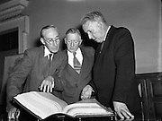 Bible- Translation of Catholic Bible into Gaelic - Presented to Ceann Comhairle at Dail Eireann by Peadar O'Dubhda..Peadar O'Dubhda (29/06/1881-05/05/1971)born in Barronstown, Co. Louth was a novelist, playwright, teacher and musician who spent twelve years of his life translating the Douay Bible into the Irish language...Although he finished his formal education when he left primary school age 12, Peadar O'Dubhda maintained a keen interest in education and even while working as a delivery boy would carry his grammar book with him at all times, eventually becoming fluent in Irish...Holding an interest in music, O'Dubhda joined the local brass band, where he initially learned to play the cornet before going on to perfect the piano, flute and violin. Not content with simply playing other people's works, he went on to compose numerous works and in 1957 when Louth went to the All Ireland final he marked the event with a musical score. ..It is his love of the Irish language that O'Dubhda is most remembered for.   It is said that he received his certificate in teaching Irish from Padraig Pearse, a leader in the 1916 Rising.  O'Dubhda went on to play a central role in founding the local Gaelic League and also travelled to numerous Gaeltacht area around the country including the Omeath Gaeltacht area closest to his home. ..He taught in St Mary's College Dundalk for over 20 years before moving to Radio Eireann for thirty years where he presented a 'Children's Hour'.  He also wrote numerous plays, stories and manuscripts over the decades...The massive undertaking of translating the Douay Bible took twelve years in which O'Dubhda translated three million words. The work was presented to the Irish nation in 1955.  ..Pope Pius XII presented the Papal medal to O'Dubhda in 1950 in recognition of 50 years membership of the St Malachy's Choir. He remained an active supporter of the Irish language up to his death, in 1971, only weeks short of his ninetieth birthday. ..His contribut