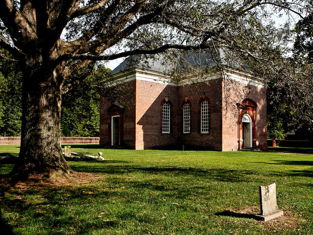 """This perfectly symmetrical central-plan Georgian church was funded by Robert """"King"""" Carter of Virginia, and built in part of his plantation, now in the town of Weems, in 1735.  His tomb and those of some of his wives are on the church property.  Still used for worship, the structure is lovingly restored and maintained by a nonprofit volunteer society."""