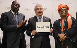 BUENOS AIRES, Oct. 9, 2018  President of the International Olympic Committee (IOC) Thomas Bach (C) shows a card with Senegalese President Macky Sall (L) and Dakar Mayor Soham El Wardini during the 133rd IOC Session in Buenos Aires, capital of Argentina, Oct. 8, 2018. Senegal was officially confirmed as the host of the 2022 Summer Youth Olympic Games at the IOC Session on Monday.  rtg) (vf) (Credit Image: © Natacha Pisarenko/Xinhua via ZUMA Wire)
