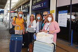 © Licensed to London News Pictures. 04/06/2021.Manchester, UK. . Helen Oakley, Sharon Graham, Carol Kettle , Carol Firth and Bev Create arrived from a Faro flight at Terminal 1 of Manchester airport. From 4am on Tuesday 8 June, Portugal will be removed from the Green list and added to the Amber list. Photo credit: Ioannis Alexopoulos/LNP