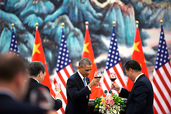 President Barack Obama offers a toast to President Xi Jinping of China during a State Banquet at the Great Hall of People in Beijing, China, Nov. 12, 2014. (Official White House Photo by Pete Souza)<br /> <br /> This official White House photograph is being made available only for publication by news organizations and/or for personal use printing by the subject(s) of the photograph. The photograph may not be manipulated in any way and may not be used in commercial or political materials, advertisements, emails, products, promotions that in any way suggests approval or endorsement of the President, the First Family, or the White House.