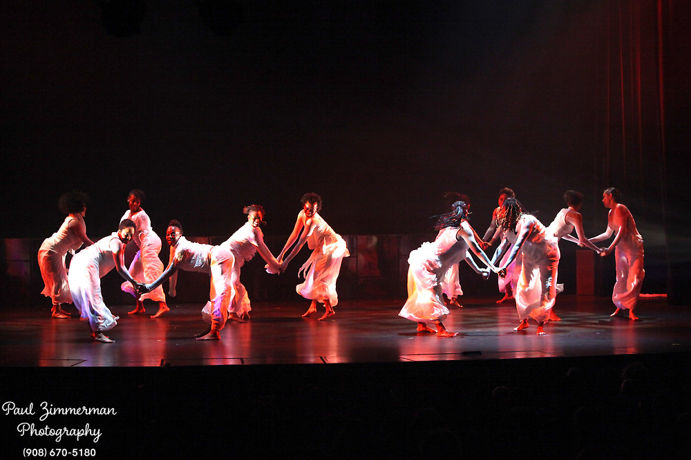 NEW YORK, NY - DECEMBER 30:  Forces of Nature Dancers perform at the 5th Annual Regeneration Night Kwanzaa Celebration at The Apollo Theater on December 30, 2011 in New York City.  (Photo by Paul Zimmerman/WireImage)