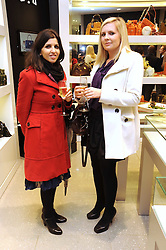 Left to right, DINA YACOB and VERITY BLAIR at the MCM Christmas party held at their store at 5 Sloane Street, London on 26th November 2008.