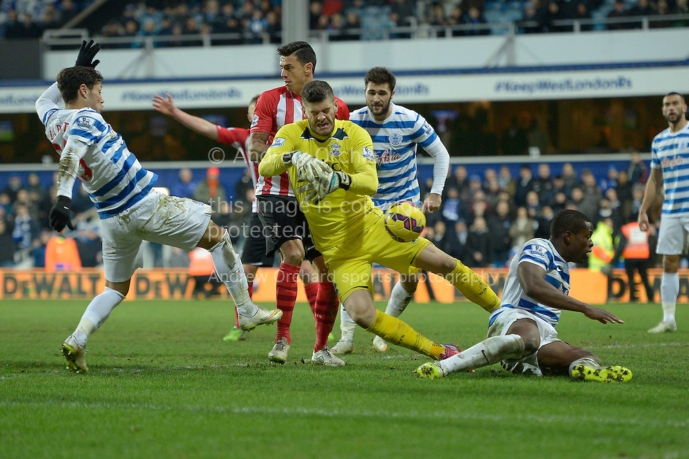 Mauro Zarate of QPR puts the ball past Goalkeeper Fraser Forster of Southampton to score but the 'goal' is disallowed,. Barclays Premier league match, Queens Park Rangers v Southampton at Loftus Road in London on Saturday 7th Feb 2015. pic by John Patrick Fletcher, Andrew Orchard sports photography.