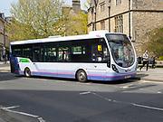Single decker First bus service in city centre, Bath, Somerset, England, UK