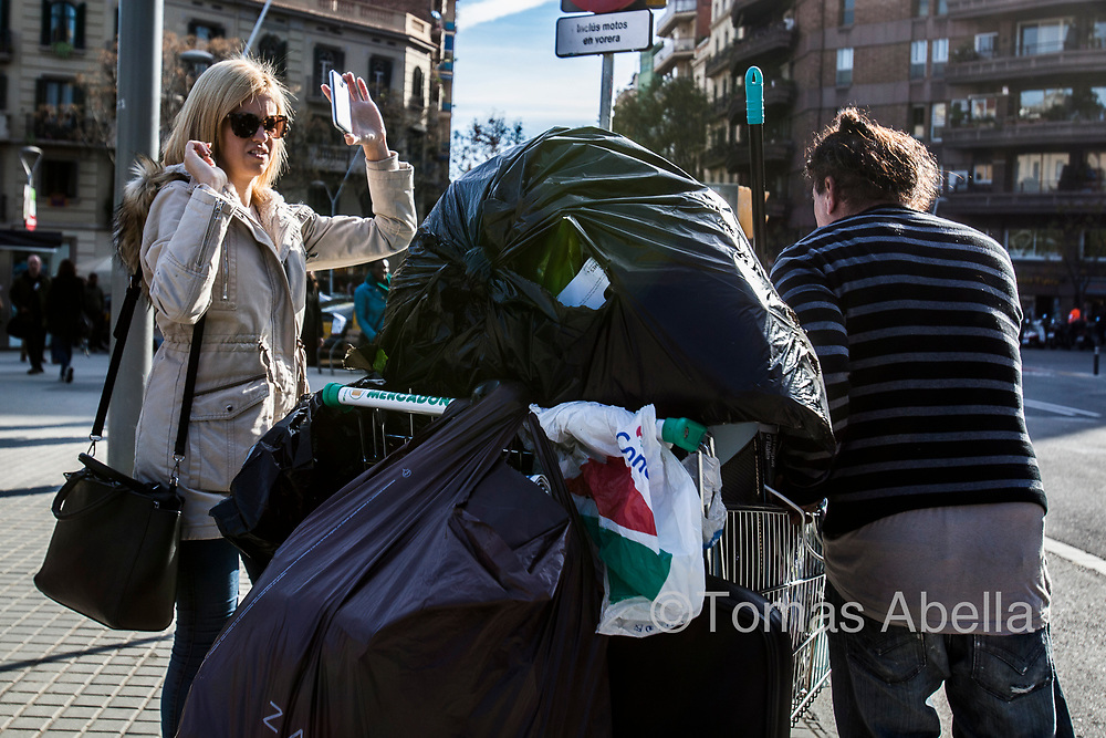 A tourist is upset by the sight of a homeless person. An estimated 3,500 homeless people are living on Barcelona's streets.