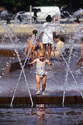 Child Playing In Water Fountain