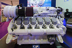 Large marine V12 diesel engine manufactured by Baudouin on display at Dubai International Boat Show 2016 , United Arab Emirates