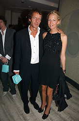 The HON.SOPHIA HESKETH and ROBIE UNIACKE at a private screening of 'Sketches of Frank Gehry in association with jewellers Tiffany held at the Curzon Cinema, Mayfair on 10th May 2006 followed by a party at Nobu Mayfair, Berkeley Street.<br /><br />NON EXCLUSIVE - WORLD RIGHTS