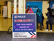 13 DECEMBER 2018 - SINGAPORE: Women walk past a police notification as they enter the Joo Chiat complex, a high rise government housing estate in the Geylang neighborhood. The Geylang area of Singapore, between the Central Business District and Changi Airport, was originally coconut plantations and Malay villages. During Singapore's boom the coconut plantations and other farms were pushed out and now the area is a working class community of Malay, Indian and Chinese people. In the 2000s, developers started gentrifying Geylang and new housing estate developments were built.       PHOTO BY JACK KURTZ