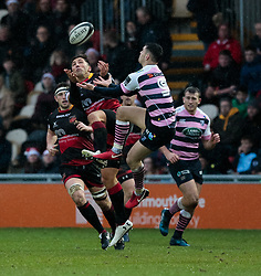 Dragons' Gavin Henson and Cardiff Blues' Tomos Williams vie for the high ball<br /> <br /> Photographer Simon King/Replay Images<br /> <br /> Guinness Pro14 Round 11 - Dragons v Cardiff Blues - Tuesday 26th December 2017 - Rodney Parade - Newport<br /> <br /> World Copyright © 2017 Replay Images. All rights reserved. info@replayimages.co.uk - www.replayimages.co.uk