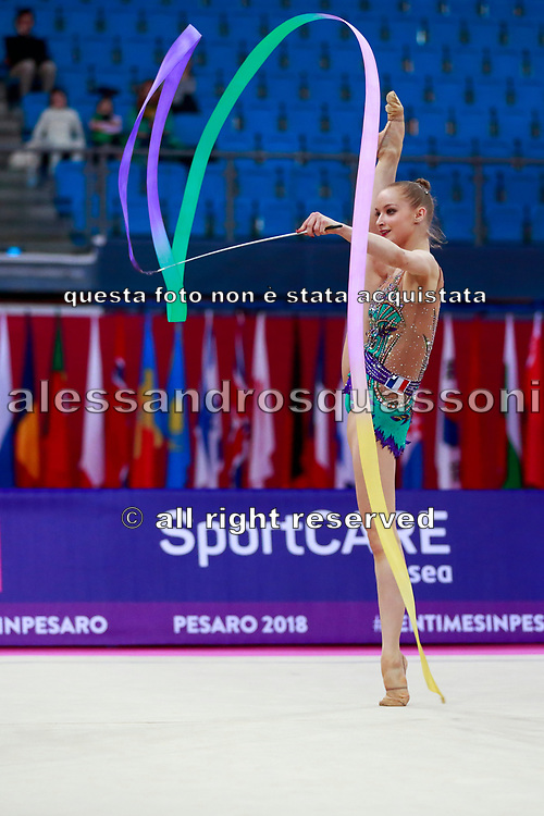 Jovenin Axelle during the qualification of the clubs at the Pesaro World Cup 2018.<br /> She is a French gymnast born in Lille in 2000. Her dream is to participate in the 2020 Olympic Games in Tokyo.