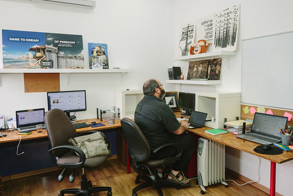 """Yehuda Shaul, co-founder and Foreign Relations Director of """"Breaking the Silence"""" is seen as they work at the offices of the organization in Ramat Gan, Israel, on February 23, 2020."""