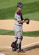 CHICAGO - JULY 09:  Joe Mauer #7 of the Minnesota Twins looks on while catching against the Chicago White Sox on July 9, 2011 at U.S. Cellular Field in Chicago, Illinois.  The White Sox defeated the Twins 4-3.  (Photo by Ron Vesely)  Subject: Joe Mauer