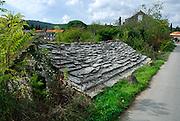 Traditional stone building by roadside, village of Zrnovo, island of Korcula, Croatia