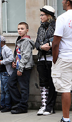 ©London News Pictures. 15/01/2011 .Picture Credit Should read Neil Hall/London News Pictures.Madonna directs her new period film W.E. starring Abbie Cornish about the abdication of King Edward in London on 08/08/2010. Pictured is Madonna with son Rocco  on set