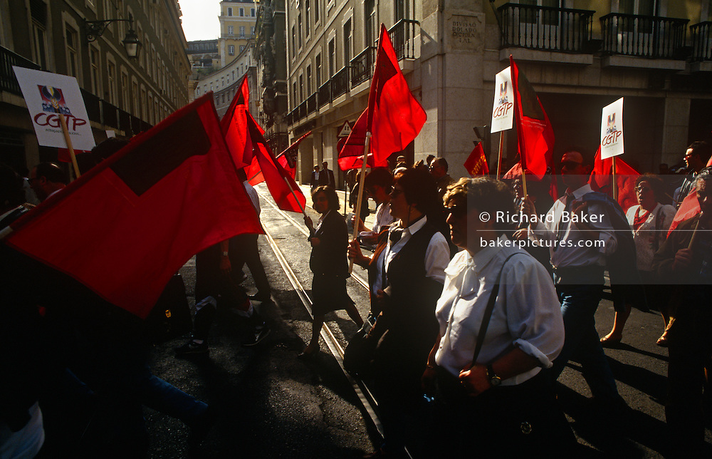 A street protest by General Confederation of the Portuguese Workers (Confederação Geral dos Trabalhadores Portugueses or CGTP). This is the largest trade union federation in Portugal, founded informally in 1970, emerged publicly after the Carnation Revolution in 1974 and was legalised the following year by the National Salvation Junta. It is traditionally influenced by the Portuguese Communist Party, and its present coordinator, Arménio Carlos, is a member of the Party.