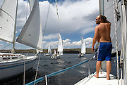 NEWS&GUIDE PHOTO / PRICE CHAMBERS.Jed Duke mans the bow of the sailboat named Karma during the Freemont Lake Regata on Saturday which was formerly known as the Little America's Cup. More than 20 mono-hull and catamaran sailboats compete in the timed race near Pinedale.