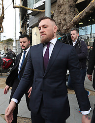 Conor McGregor leaves Dublin District Court after appearing in relation to motoring offences.