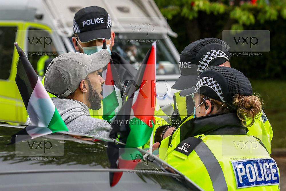 """Leicester, United Kingdom, May 24, 2021: Two local residents who were trying to provide food to the """"Palestine Action"""" activists were arrested by police in Leicester on Monday, May 24, 2021. Another local resident who was filming from his own private car got also arrested (in picture). (Photo by Vudi Xhymshiti)<br /> <br /> Police protestor removal crew arrived at the building of the Israeli-owned Elbit-Thale subsidiary UAV Tactical Systems after it has been occupied for six consecutive days by the """"Palestine Action"""" activists' group. Both remaining activists were removed from the rooftop and arrested, meanwhile local communities' have organised a barricade and appear to be determined to not let the police leave the area with activists. """"Shut Elbit Down"""", """"Free! Free! Palestine"""" are among the slogans local residents are shouting."""