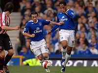 Photo: Paul Greenwood.<br />Everton v Sheffield United. The Barclays Premiership. 21/10/2006. Everton players Simon Davies, left and Joleon Lescott (16) tackle each other.