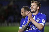 Josh Law of Oldham Athletic applauds the home fans after scoring what proved to be the winner in the EFL Cup match between Oldham Athletic and Wigan Athletic at Boundary Park, Oldham, England on 9 August 2016. Photo by Simon Brady.