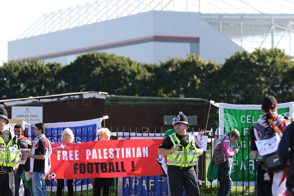 Pro-Palestinian campaigners protest against Israel's match with Wales in the UEFA Championships. Campaigners call for Israel to be kicked out of UEFA and FIFA because of its occupation of Palestine and restrictions on freedom of movement of Palestinian footballers.