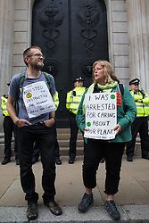 London, UK. 2nd September, 2021. Extinction Rebellion climate activists call for Andrew Bailey, Governor of the Bank of England, to come out to speak with them on the eleventh day of their Impossible Rebellion protests. The activists included over fifty wearing signs indicating that they were breaking restrictive bail conditions by entering the City of London. Extinction Rebellion are calling on the UK government to cease all new fossil fuel investment with immediate effect.