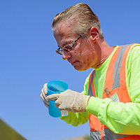 081915       Cable Hoover<br /> <br /> John Isham of the environmental consulting firm Iina' Ba' test water from a relief water tank in Shiprock Wednesday.