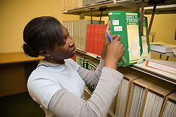University student looking at books in the College Library,