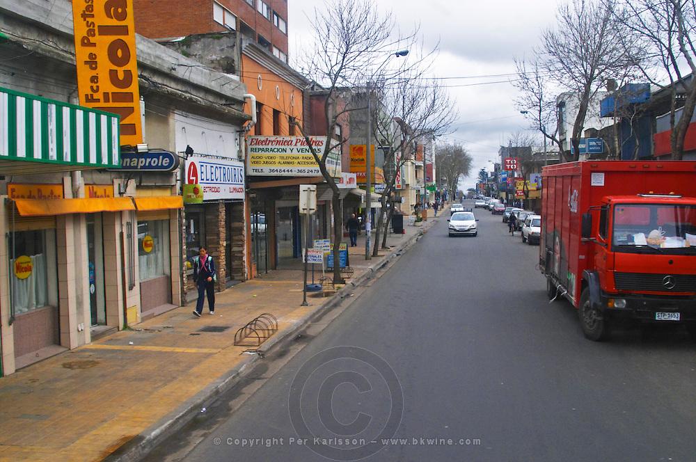 Street scene in the town Progreso, shops and cars. Bodega Castillo Viejo Winery, Las Piedras, Canelones, Uruguay, South America