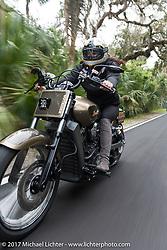 Klock Werks Karlee Kobb of SD riding her custom Indian Scout through Tamoka State Park during Daytona Beach Bike Week. FL. USA. Monday March 13, 2017. Photography ©2017 Michael Lichter.
