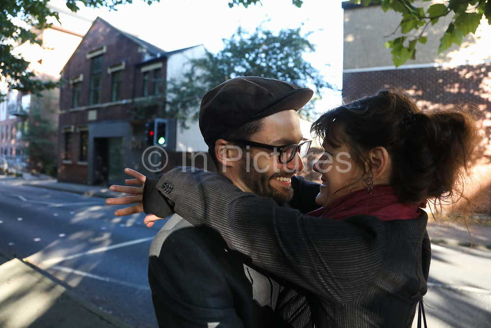 """Roscoe and his partner having a moment before arriving to Preston Crown Court,September 25th, Preston, Lancashire, United Kingdom. Simon Roscoe Blevins was sentenced to 16 months in prison for his part in the Frack Free Four truck surfer trial at Preston Crown Court Sept 26 2018. Simon Roscoe Blevins, 26,  Richard Loizou, 31, Richard Roberts, 36 and Julian Brock, 47 climbed on top of several trucks during a mass protest by locals and supporters in New Preston Road, against fracking in Lancashire, July 2017. The trucks were prevented form delivering equipment to Cuadrillas nearby fracking site for four days. After a seven day jury trial at Preston Crown Court in August 2018, the four men were found guilty of Public Nuisance. Judge Altham has told them to expect """"immediate custodial sentences"""" on 25th September 2018."""