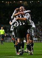 Photo: Andrew Unwin.<br /> Newcastle United v Celta Vigo. UEFA Cup. 23/11/2006.<br /> Newcastle's Antoine Sibierski (R) celebrates his goal.