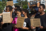 Young people hold signs bearing the names of people who died due to racial violence or in custody during a peaceful protest in solidarity with the Black Lives Matter movement on 13th June 2020 in Salt Hill Park in Slough, United Kingdom. Protests in solidarity with the Black Lives Matter movement have taken place across the United States and in many countries around the world.